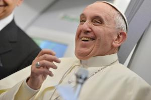"""Pope Francis smiles as he answers reporters questions during a news conference aboard the papal flight on the journey back from Brazil, Monday, July 29, 2013. Pope Francis reached out to gays on Monday, saying he wouldn't judge priests for their sexual orientation in a remarkably open and wide-ranging news conference as he returned from his first foreign trip. """"If someone is gay and he searches for the Lord and has good will, who am I to judge?"""" Francis asked. His predecessor, Pope Benedict XVI, signed a document in 2005 that said men with deep-rooted homosexual tendencies should not be priests. Francis was much more conciliatory, saying gay clergymen should be forgiven and their sins forgotten. Francis' remarks came Monday during a plane journey back to the Vatican from his first foreign trip in Brazil. (AP Photo/Luca Zennaro, Pool)"""